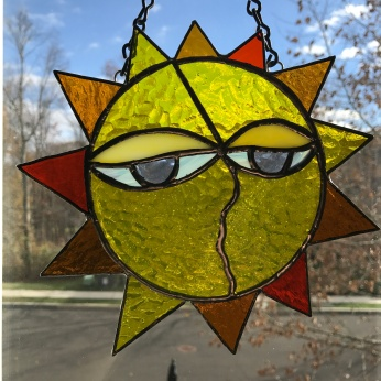 stained-glass-sun-face-1